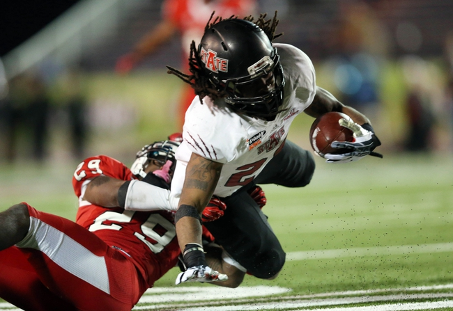 Jan 5, 2014; Mobile, AL, USA; Arkansas State Red Wolves wide receiver J.D. McKissic (23) is tackled by Ball State Cardinals safety Brian Jones (29) in the second half at Ladd-Peebles Stadium. Arkansas State Red Wolves defeated the Ball State Cardinals 23-20. Mandatory Credit: Crystal LoGiudice-USA TODAY Sports