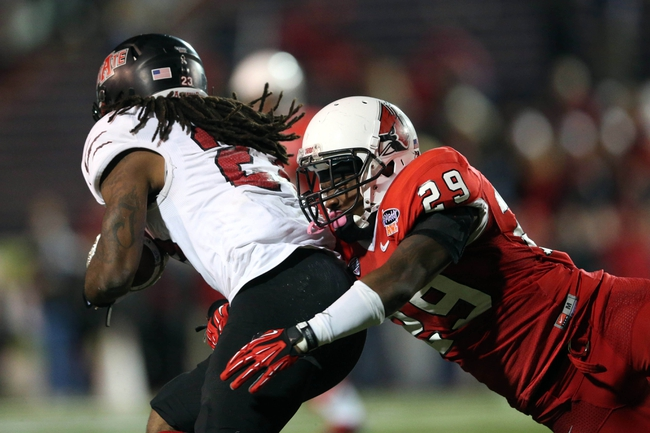 Jan 5, 2014; Mobile, AL, USA; Ball State Cardinals safety Brian Jones (29) tackles Arkansas State Red Wolves wide receiver J.D. McKissic (23)  in the second half at Ladd-Peebles Stadium. Arkansas State Red Wolves defeated the Ball State Cardinals 23-20. Mandatory Credit: Crystal LoGiudice-USA TODAY Sports