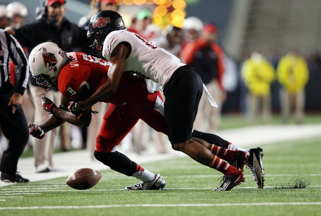 Jan 5, 2014; Mobile, AL, USA; Ball State Cardinals wide receiver Jordan Williams (8) is tackled by Arkansas State Red Wolves defensive back Artez Brown (10) after Brown broke up the pass in the second half at Ladd-Peebles Stadium. Arkansas State Red Wolves defeated the Ball State Cardinals 23-20. Mandatory Credit: Crystal LoGiudice-USA TODAY Sports