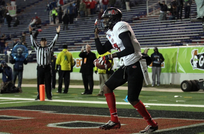 Jan 5, 2014; Mobile, AL, USA; Arkansas State Red Wolves wide receiver Allen Muse (17) celebrates a touchdown against the Ball State Cardinals in the second half at Ladd-Peebles Stadium. Arkansas State Red Wolves defeated the Ball State Cardinals 23-20. Mandatory Credit: Crystal LoGiudice-USA TODAY Sports