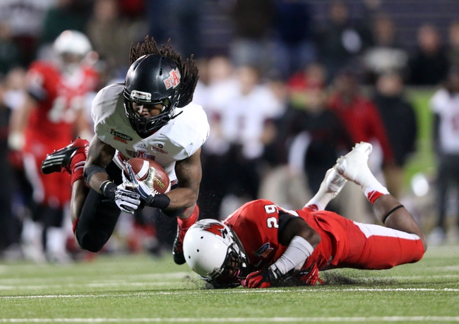 Jan 5, 2014; Mobile, AL, USA; Arkansas State Red Wolves wide receiver J.D. McKissic (23) is tripped up by Arkansas State Red Wolves defensive back Chris Humes (29) as he carries the ball in the second half at Ladd-Peebles Stadium. Arkansas State Red Wolves defeated the Ball State Cardinals 23-20. Mandatory Credit: Crystal LoGiudice-USA TODAY Sports