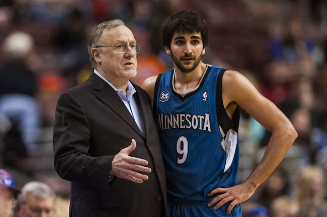 Jan 6, 2014; Philadelphia, PA, USA; Minnesota Timberwolves head coach Rick Adelman talks with guard Ricky Rubio (9) during the third quarter against the Philadelphia 76ers at the Wells Fargo Center. The Timberwolves defeated the Sixers 126-95. Mandatory Credit: Howard Smith-USA TODAY Sports