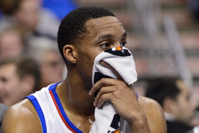 Jan 6, 2014; Philadelphia, PA, USA; Philadelphia 76ers guard Evan Turner (12) watches from the bench during the third quarter against the Minnesota Timberwolves at the Wells Fargo Center. The Timberwolves defeated the Sixers 126-95. Mandatory Credit: Howard Smith-USA TODAY Sports