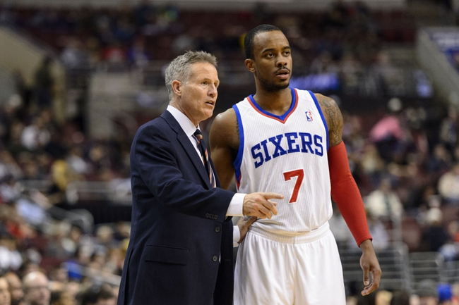 Jan 6, 2014; Philadelphia, PA, USA; Philadelphia 76ers head coach Brett Brown talks with guard Lorenzo Brown (7) during the third quarter against the Minnesota Timberwolves at the Wells Fargo Center. The Timberwolves defeated the Sixers 126-95. Mandatory Credit: Howard Smith-USA TODAY Sports