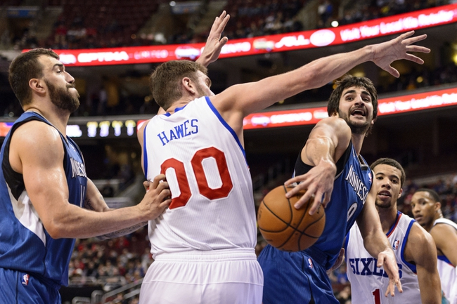 Jan 6, 2014; Philadelphia, PA, USA; Minnesota Timberwolves guard Ricky Rubio (9) passes the ball during the third quarter against the Philadelphia 76ers at the Wells Fargo Center. The Timberwolves defeated the Sixers 126-95. Mandatory Credit: Howard Smith-USA TODAY Sports