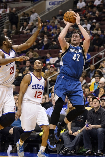 Jan 6, 2014; Philadelphia, PA, USA; Minnesota Timberwolves forward Kevin Love (42) shoots after being fouled by Philadelphia 76ers guard Evan Turner (12) during the third quarter at the Wells Fargo Center. The Timberwolves defeated the Sixers 126-95. Mandatory Credit: Howard Smith-USA TODAY Sports