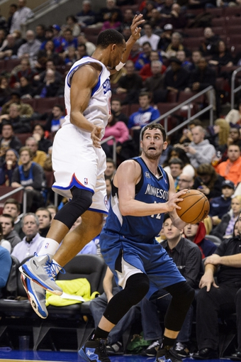 Jan 6, 2014; Philadelphia, PA, USA; Minnesota Timberwolves forward Kevin Love (42) reacts as he is about to be fouled by Philadelphia 76ers guard Evan Turner (12) during the third quarter at the Wells Fargo Center. The Timberwolves defeated the Sixers 126-95. Mandatory Credit: Howard Smith-USA TODAY Sports