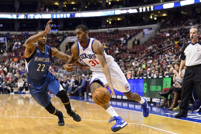 Jan 6, 2014; Philadelphia, PA, USA; Philadelphia 76ers forward Hollis Thompson (31) is defended by Minnesota Timberwolves guard A.J. Price (22) during the fourth quarter at the Wells Fargo Center. The Timberwolves defeated the Sixers 126-95. Mandatory Credit: Howard Smith-USA TODAY Sports