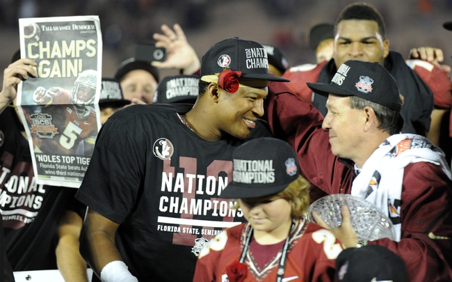 Jan 6, 2014; Pasadena, CA, USA; Florida State Seminoles head coach Jimbo Fisher (right) celebrates with quarterback Jameis Winston (left) after the 2014 BCS National Championship game against the Auburn Tigers at the Rose Bowl.  Mandatory Credit: Kirby Lee-USA TODAY Sports