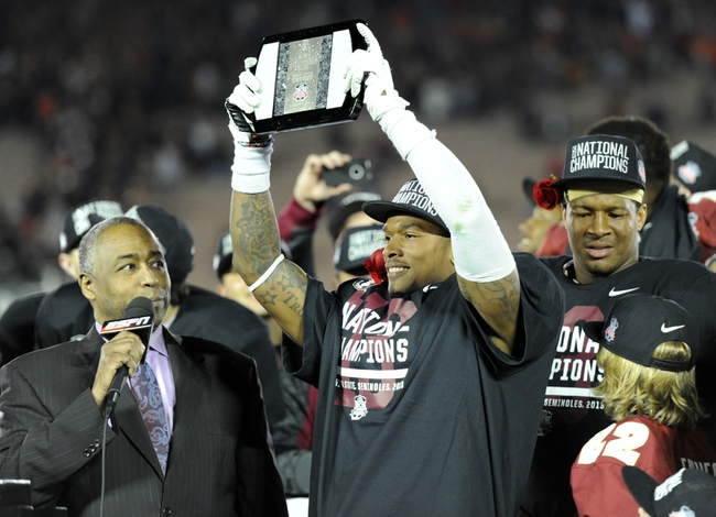 Jan 6, 2014; Pasadena, CA, USA; Florida State Seminoles defensive back P.J. Williams (26) holds the MVP trophy after the 2014 BCS National Championship game against the Auburn Tigers at the Rose Bowl.  Mandatory Credit: Kirby Lee-USA TODAY Sports