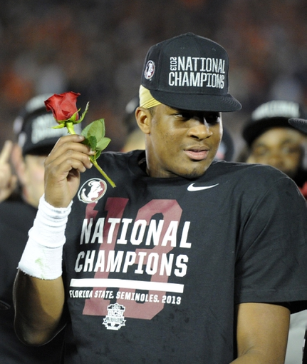 Jan 6, 2014; Pasadena, CA, USA; Florida State Seminoles quarterback Jameis Winston (5) celebrates after the 2014 BCS National Championship game against the Auburn Tigers at the Rose Bowl.  Mandatory Credit: Kirby Lee-USA TODAY Sports