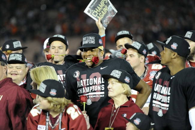 Jan 6, 2014; Pasadena, CA, USA; Florida State Seminoles quarterback Jameis Winston (middle) celebrates with teammates after the 2014 BCS National Championship game against the Auburn Tigers at the Rose Bowl.  Mandatory Credit: Kirby Lee-USA TODAY Sports
