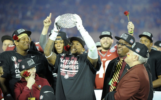 Jan 6, 2014; Pasadena, CA, USA; Florida State Seminoles defensive back P.J. Williams (26) holds the Coaches Trophy after the 2014 BCS National Championship game against the Auburn Tigers at the Rose Bowl.  Mandatory Credit: Kirby Lee-USA TODAY Sports