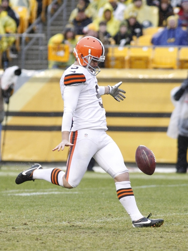Dec 29, 2013; Pittsburgh, PA, USA; Cleveland Browns punter Spencer Lanning (5) punts the ball to the Pittsburgh Steelers during the fourth quarter at Heinz Field. The Steelers won 20-7. Mandatory Credit: Charles LeClaire-USA TODAY Sports