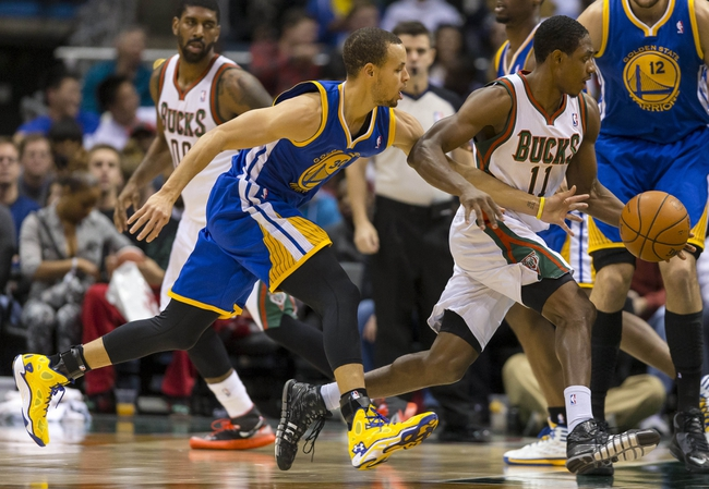 Jan 7, 2014; Milwaukee, WI, USA; Golden State Warriors guard Stephen Curry (30) defends Milwaukee Bucks guard Brandon Knight (11) during the second quarter at BMO Harris Bradley Center. Mandatory Credit: Jeff Hanisch-USA TODAY Sports
