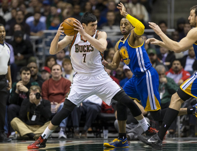 Jan 7, 2014; Milwaukee, WI, USA; Milwaukee Bucks forward Ersan Ilyasova (7) dribbles the ball as Golden State Warriors forward Andre Iguodala (9) defends during the second quarter at BMO Harris Bradley Center. Mandatory Credit: Jeff Hanisch-USA TODAY Sports