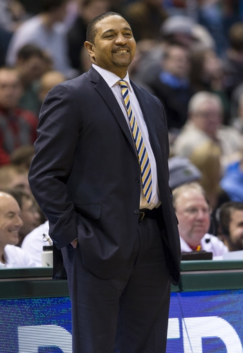 Jan 7, 2014; Milwaukee, WI, USA; Golden State Warriors head coach Mark Jackson looks on from the sidelines during the second quarter against the Milwaukee Bucks at BMO Harris Bradley Center. Mandatory Credit: Jeff Hanisch-USA TODAY Sports