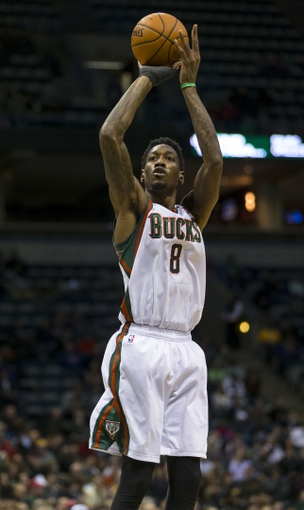 Jan 7, 2014; Milwaukee, WI, USA; Milwaukee Bucks center Larry Sanders (8) shoots the ball during the third quarter against the Golden State Warriors at BMO Harris Bradley Center. Mandatory Credit: Jeff Hanisch-USA TODAY Sports