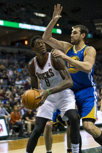 Jan 7, 2014; Milwaukee, WI, USA; Milwaukee Bucks center Larry Sanders (8) prepares to shoot the ball as Golden State Warriors center Andrew Bogut (12) defends during the third quarter at BMO Harris Bradley Center. Mandatory Credit: Jeff Hanisch-USA TODAY Sports
