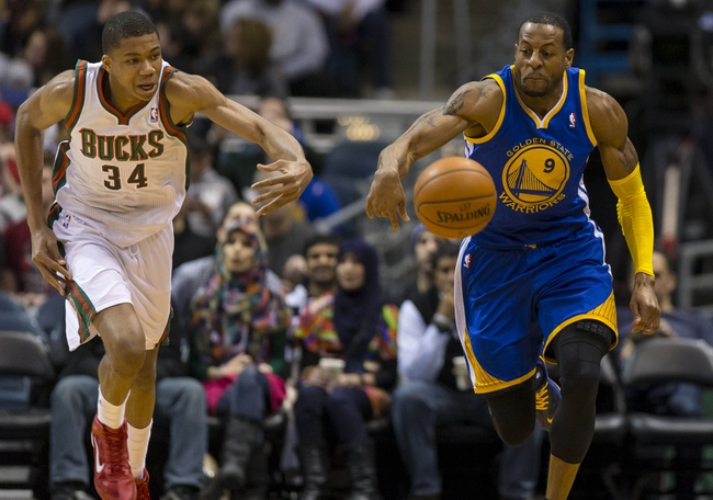Jan 7, 2014; Milwaukee, WI, USA; Milwaukee Bucks guard Giannis Antetokounmpo (34) and Golden State Warriors forward Andre Iguodala (9) battle for the ball during the third quarter at BMO Harris Bradley Center. Mandatory Credit: Jeff Hanisch-USA TODAY Sports