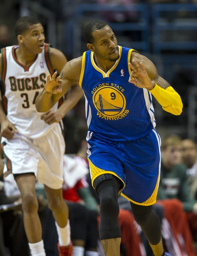 Jan 7, 2014; Milwaukee, WI, USA; Golden State Warriors forward Andre Iguodala (9) celebrates after making a basket during the third quarter against the Milwaukee Bucks at BMO Harris Bradley Center. Mandatory Credit: Jeff Hanisch-USA TODAY Sports