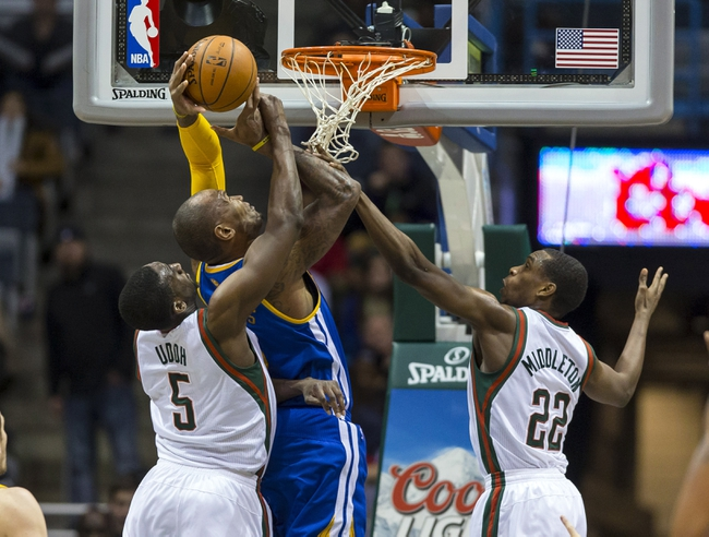 Jan 7, 2014; Milwaukee, WI, USA; Golden State Warriors forward Marreese Speights (5) shoots between Milwaukee Bucks forwards Ekpe Udoh (5) Khris Middleton (22)  during the fourth quarter at BMO Harris Bradley Center. Mandatory Credit: Jeff Hanisch-USA TODAY Sports