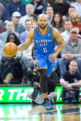 Jan 7, 2014; Salt Lake City, UT, USA; Oklahoma City Thunder point guard Derek Fisher (6) dribbles up the court during the first half against the Utah Jazz at EnergySolutions Arena. Mandatory Credit: Russ Isabella-USA TODAY Sports