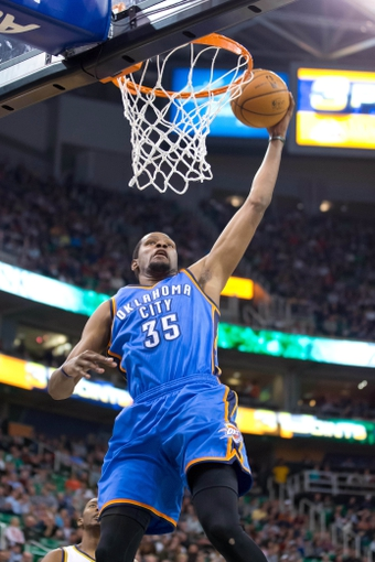 Jan 7, 2014; Salt Lake City, UT, USA; Oklahoma City Thunder small forward Kevin Durant (35) dunks during the first half against the Utah Jazz at EnergySolutions Arena. Mandatory Credit: Russ Isabella-USA TODAY Sports