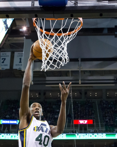Jan 7, 2014; Salt Lake City, UT, USA; Utah Jazz small forward Jeremy Evans (40) goes to the basket during the first half against the Oklahoma City Thunder at EnergySolutions Arena. Mandatory Credit: Russ Isabella-USA TODAY Sports