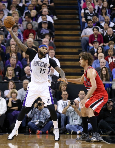 Jan 7, 2014; Sacramento, CA, USA; Sacramento Kings center DeMarcus Cousins (15) controls a pass against Portland Trail Blazers center Robin Lopez (42) during the second quarter at Sleep Train Arena. Mandatory Credit: Kelley L Cox-USA TODAY Sports