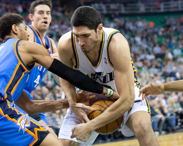 Jan 7, 2014; Salt Lake City, UT, USA; Oklahoma City Thunder shooting guard Jeremy Lamb (11) and Utah Jazz center Enes Kanter (0) fight for a loose ball during the second half at EnergySolutions Arena. The Jazz won 112-101. Mandatory Credit: Russ Isabella-USA TODAY Sports