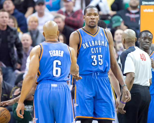 Jan 7, 2014; Salt Lake City, UT, USA; Oklahoma City Thunder point guard Derek Fisher (6) and small forward Kevin Durant (35) react during the second half against the Utah Jazz at EnergySolutions Arena. The Jazz won 112-101. Mandatory Credit: Russ Isabella-USA TODAY Sports