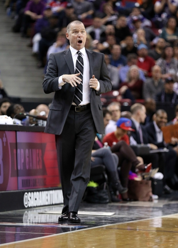 Jan 7, 2014; Sacramento, CA, USA; Sacramento Kings head coach Michael Malone calls out to his players during the third quarter against the Portland Trail Blazers at Sleep Train Arena. The Sacramento Kings defeated the Portland Trail Blazers 123-119. Mandatory Credit: Kelley L Cox-USA TODAY Sports