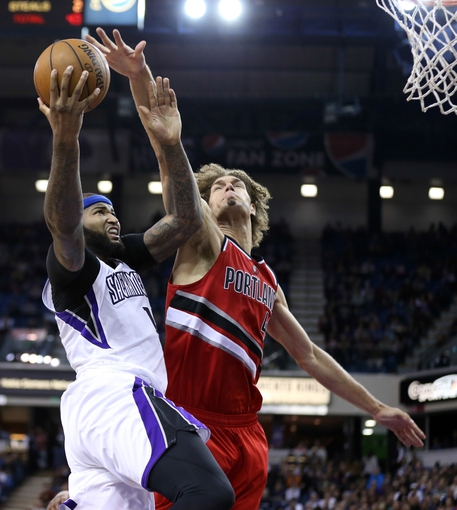 Jan 7, 2014; Sacramento, CA, USA; Sacramento Kings center DeMarcus Cousins (15) goes up for a shot against Portland Trail Blazers center Robin Lopez (42) during the fourth quarter at Sleep Train Arena. The Sacramento Kings defeated the Portland Trail Blazers 123-119. Mandatory Credit: Kelley L Cox-USA TODAY Sports