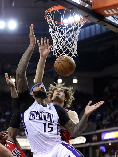 Jan 7, 2014; Sacramento, CA, USA; Sacramento Kings center DeMarcus Cousins (15) gathers a rebound against Portland Trail Blazers center Robin Lopez (42) during the fourth quarter at Sleep Train Arena. The Sacramento Kings defeated the Portland Trail Blazers 123-119. Mandatory Credit: Kelley L Cox-USA TODAY Sports