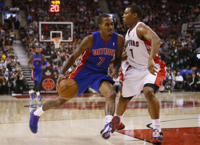 Jan 8, 2014; Toronto, Ontario, CAN; Toronto Raptors guard Kyle Lowry (7) defends against Detroit Pistons guard Brandon Jennings (7) at the Air Canada Centre. Toronto defeated Detroit 112-91. Mandatory Credit: John E. Sokolows