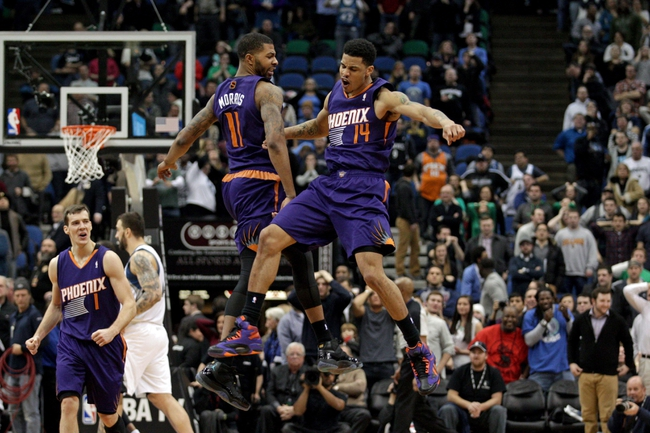 Jan 8, 2014; Minneapolis, MN, USA; Phoenix Suns guard Gerald Green (14) celebrates with forward Markieff Morris (11) during the fourth quarter against the Minnesota Timberwolves at Target Center. The Suns defeated the Timberwolves 104-103. Mandatory Credit: Brace Hemmelgarn-USA TODAY Sports
