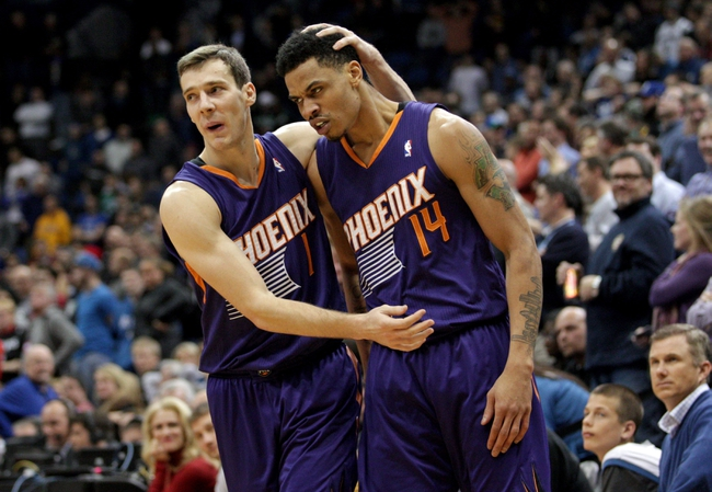 Jan 8, 2014; Minneapolis, MN, USA; Phoenix Suns guard Goran Dragic (1) congratulates guard Gerald Green (14) during the fourth quarter against the Minnesota Timberwolves at Target Center. The Suns defeated the Timberwolves 104-103. Mandatory Credit: Brace Hemmelgarn-USA TODAY Sports