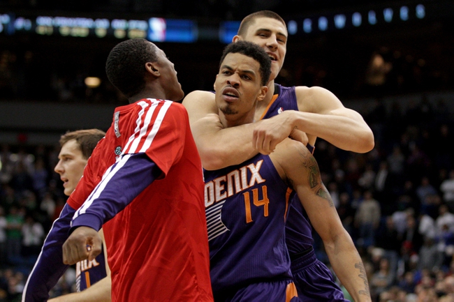 Jan 8, 2014; Minneapolis, MN, USA; Phoenix Suns guard Gerald Green (14) celebrates with center Alex Len (21) during the fourth quarter against the Minnesota Timberwolves at Target Center. The Suns defeated the Timberwolves 104-103. Mandatory Credit: Brace Hemmelgarn-USA TODAY Sports