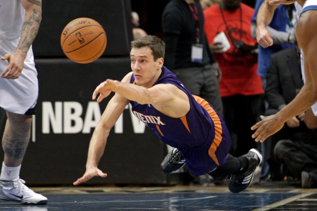 Jan 8, 2014; Minneapolis, MN, USA; Phoenix Suns guard Goran Dragic (1) dives for a loose ball during the third quarter against the Minnesota Timberwolves at Target Center. The Suns defeated the Timberwolves 104-103. Mandatory Credit: Brace Hemmelgarn-USA TODAY Sports