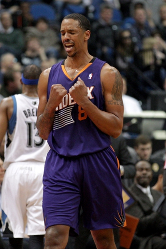 Jan 8, 2014; Minneapolis, MN, USA; Phoenix Suns forward Channing Frye (8) reacts during the third quarter against the Minnesota Timberwolves at Target Center. The Suns defeated the Timberwolves 104-103. Mandatory Credit: Brace Hemmelgarn-USA TODAY Sports