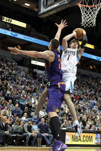 Jan 8, 2014; Minneapolis, MN, USA; Minnesota Timberwolves guard Alexey Shved (1) shoots over Phoenix Suns center Alex Len (21) during the fourth quarter at Target Center. The Suns defeated the Timberwolves 104-103. Mandatory Credit: Brace Hemmelgarn-USA TODAY Sports