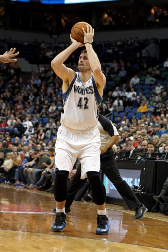 Jan 8, 2014; Minneapolis, MN, USA; Minnesota Timberwolves forward Kevin Love (42) shoots during the third quarter against the Phoenix Suns at Target Center. The Suns defeated the Timberwolves 104-103. Mandatory Credit: Brace Hemmelgarn-USA TODAY Sports