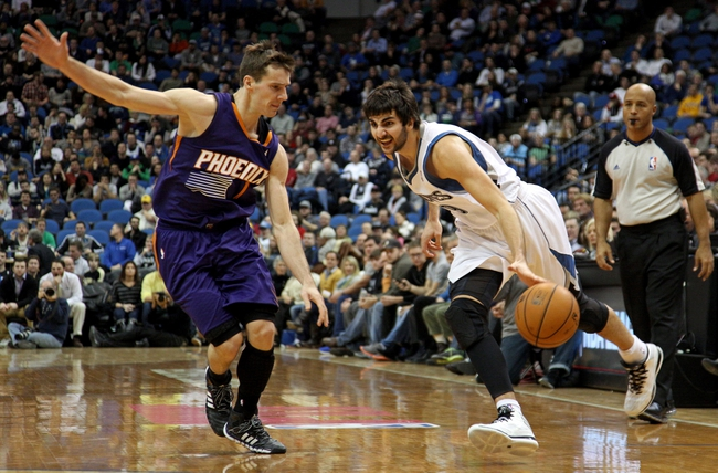 Jan 8, 2014; Minneapolis, MN, USA; Minnesota Timberwolves guard Ricky Rubio (9) drives past Phoenix Suns guard Goran Dragic (1) during the fourth quarter at Target Center. The Suns defeated the Timberwolves 104-103. Mandatory Credit: Brace Hemmelgarn-USA TODAY Sports