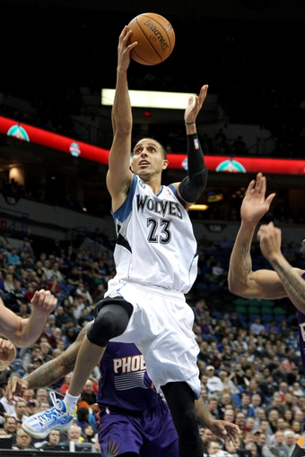 Jan 8, 2014; Minneapolis, MN, USA; Minnesota Timberwolves guard Kevin Martin (23) shoots during the fourth quarter against the Phoenix Suns at Target Center. The Suns defeated the Timberwolves 104-103. Mandatory Credit: Brace Hemmelgarn-USA TODAY Sports