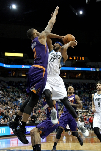 Jan 8, 2014; Minneapolis, MN, USA; Minnesota Timberwolves forward Corey Brewer (13) shoots over Phoenix Suns forward Markieff Morris (11) during the fourth quarter at Target Center. The Suns defeated the Timberwolves 104-103. Mandatory Credit: Brace Hemmelgarn-USA TODAY Sports