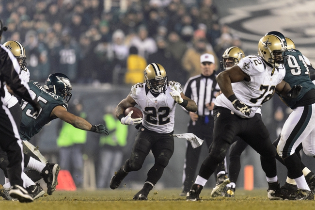 Jan 4, 2014; Philadelphia, PA, USA; New Orleans Saints running back Mark Ingram (22) carries the ball during the fourth quarter against the Philadelphia Eagles during the 2013 NFC wild card playoff football game at Lincoln Financial Field. The Saints defeated the Eagles 26-24. Mandatory Credit: Howard Smith-USA TODAY Sports
