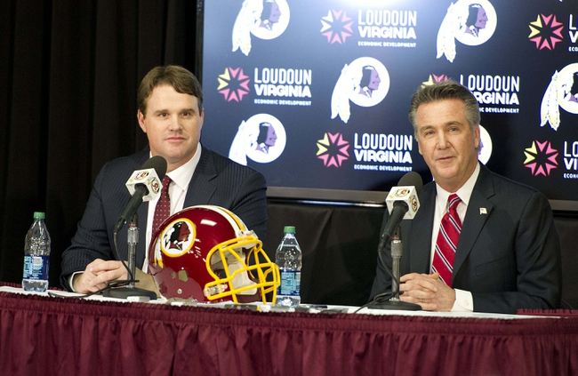 Jan 9, 2014; Ashburn, VA, USA; Washington Redskins head coach Jay Gruden is introduced by general manager Bruce Allen during a press conferences at Redskins Park Team Auditorium. Mandatory Credit: Brad Mills-USA TODAY Sports