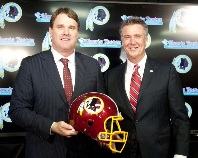 Jan 9, 2014; Ashburn, VA, USA; Washington Redskins head coach Jay Gruden and general manager Bruce Allen pose for a photo after a press conferences at Redskins Park Team Auditorium. Mandatory Credit: Brad Mills-USA TODAY Sports