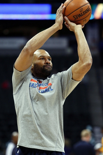 Jan 9, 2014; Denver, CO, USA; Oklahoma City Thunder point guard Derek Fisher (6) warms up before the start of the game against the Denver Nuggets at the Pepsi Center. Mandatory Credit: Isaiah J. Downing-USA TODAY Sports